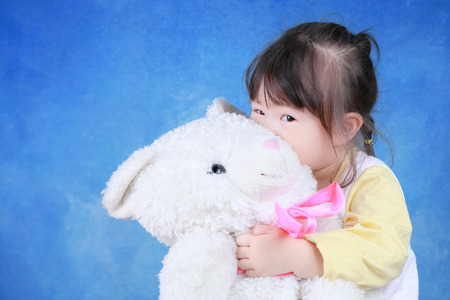 stuffed toys: Portrait of little girl with teddy bear