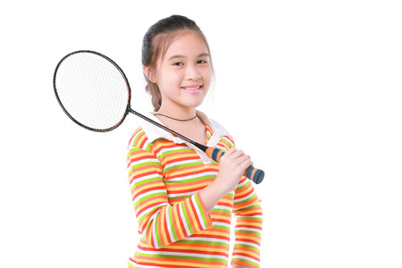 Cute little girl playing badminton photo