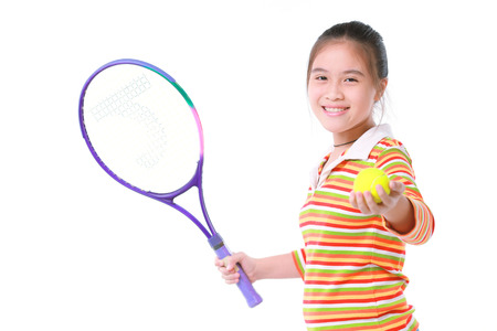 Little girl playing tennis on white background photo