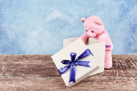 Gift box with teddy bear photo