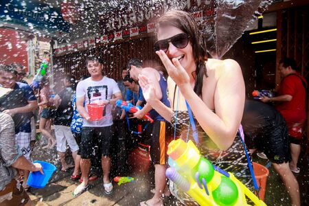 mai: CHIANG MAI THAILAND-APRIL 13:Chiang mai Songkran festival. Foreign tourists and Thai people enjoy splashing water. on April 13,2014 in Chiang mai,Thailand. Editorial