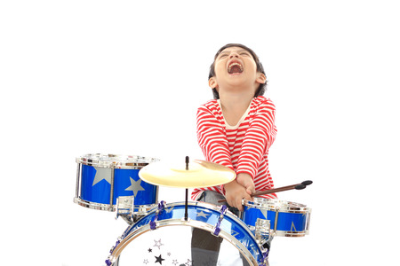 drum and bass: Asian young boy playing blue drum on white background