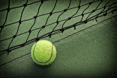 to play ball: Tennis ball on tennis court Stock Photo