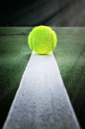 Tennis ball on tennis court Foto de archivo