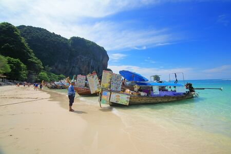 railey: KRABI THAILAND-APRIL 29, 2015 : Traditional  restaurant boats on the Railey beach. Railey beach  in Krabi province  and a famous travel destination.