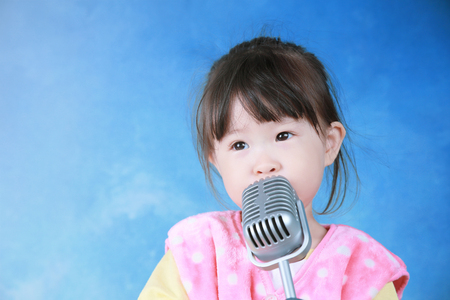 female child: little girl with vintage microphone Stock Photo