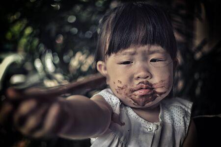 poor children: poor children eating ice cream Stock Photo