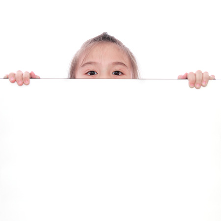 child holding sign: cute little girl behind white board Stock Photo