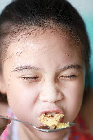 hungry kid: Little asian girl eating food