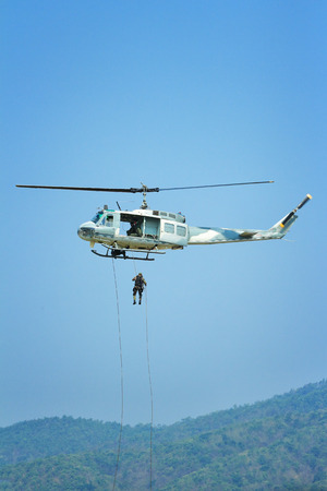 rappelling: Soldier rappelling from a helicopter