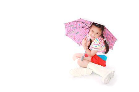asia children: little girl with umbrella over white background Stock Photo