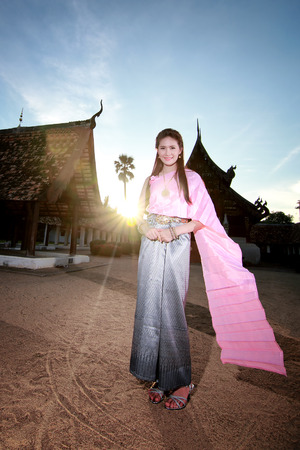 thailand art: Women in thai dress at the old temple Stock Photo
