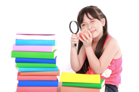 kids background: Student little asian girl reading the book