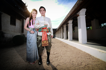 thai art: Couple thai dress in the old temple