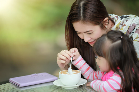 having lunch: Young mother relaxing together with her little child  girl in summer outdoors
