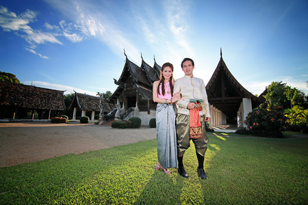 thai culture: Couple thai dress in the old temple