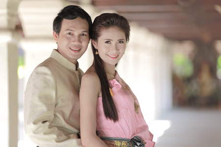 thailand culture: Couple thai dress in the old temple