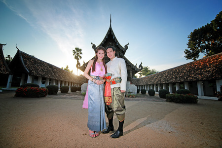 cultural history: Couple thai dress in the old temple