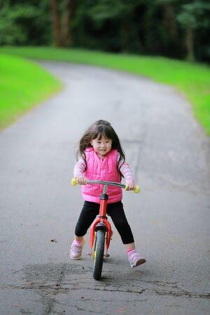 kids outside: asian little girl on balance bike