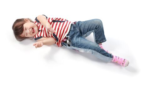 girl lying: Happy asian little girl lying on white background