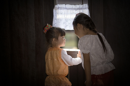 thai culture: Little girl wearing traditional thai dress in ancient thai house