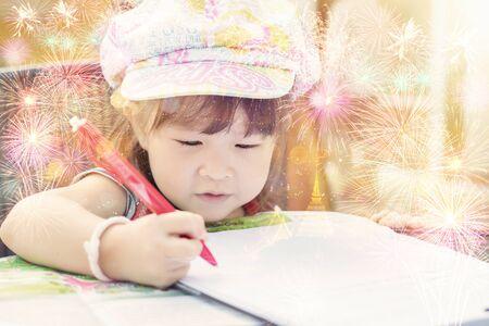 multiple exposure: Asian little girl writing on paper Multiple Exposure effect