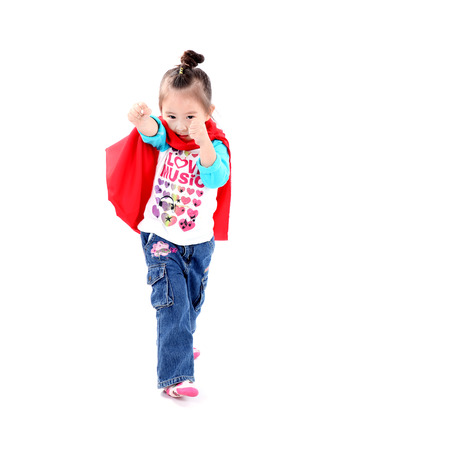 Superhero little asian girl in a red raincoat on white background