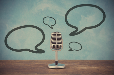 Retro style microphone with blank balloons text box Standard-Bild