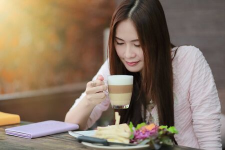 Beautiful asian gril drinking coffee in cafe restaurant photo