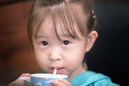 suck: little girl drinking juices