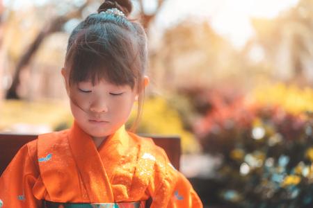 Little girl in traditional japanese kimono at autumn Standard-Bild - 111835699