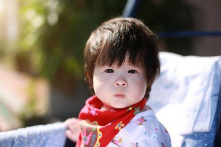 Cute asian Baby in a stroller