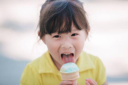 Asian little girl eating icecream