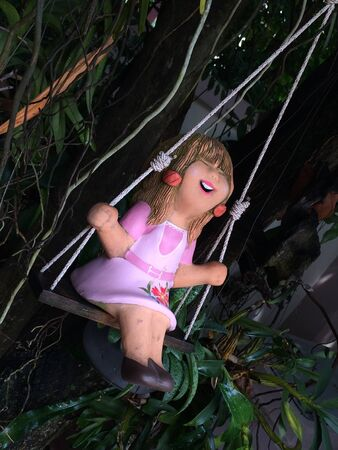 doll: doll of a girl on swing