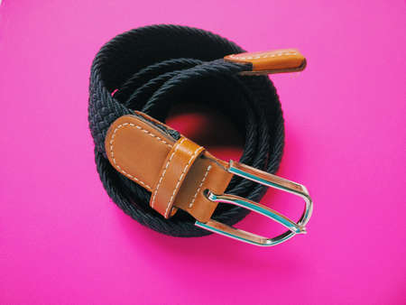 braided: Braided belt for men on pink . Stock Photo