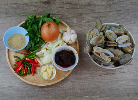 Ingredients for fried short necked clam with chili paste and thai basil leaf.