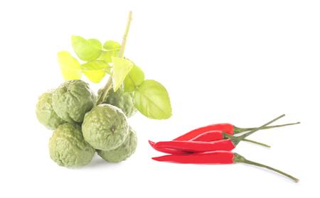 peper: Bergamot fruit and red peper on white background. Stock Photo