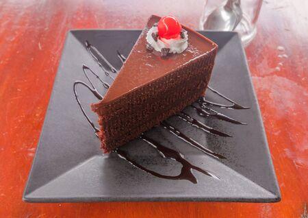 trozo de pastel: Un pedazo de pastel de chocolate