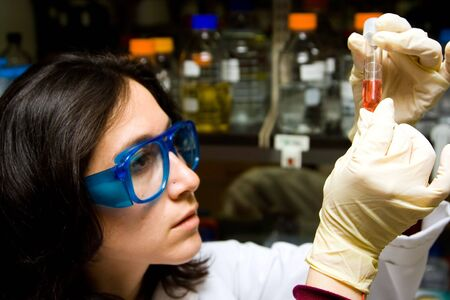 Scientist is checking the color change of a reaction in a test tube Stok Fotoğraf