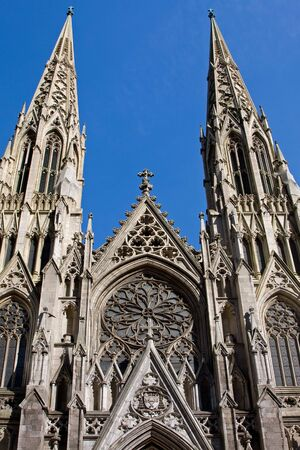 The facade of the Saint Patrick Cathedral in New York City on a deep blue sky