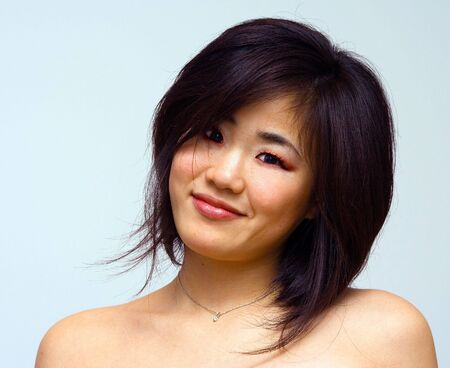 taiwanese: Beautiful sexy Oriental woman with  shoulders laughing
