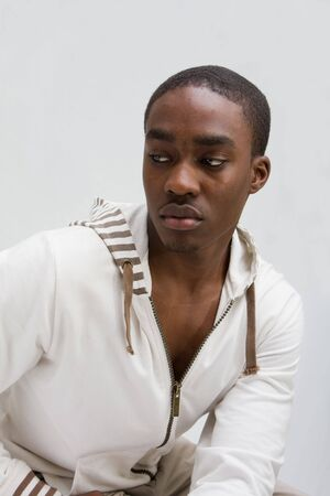 Young dark skinned handsome guy dressed in white, solated Stock Photo - 3141210