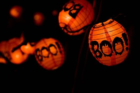Boo! lampions for Halloween expressing horror.
