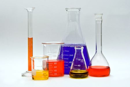 ph: Flasks, cylinders and beakers with colorful liquids as pH indicators on a white background