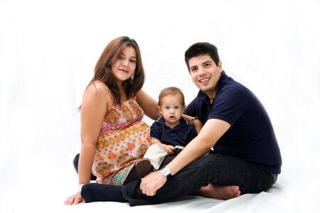 Mother, father and son as a young new family sitting together, isolated