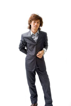 Young Asian business man dressed in a gray pinstripe suit with hand on back and button, isolated