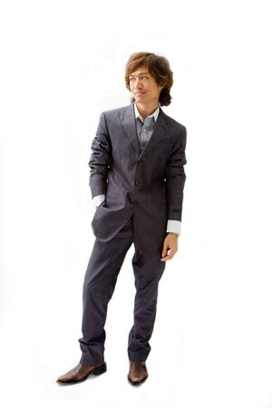 Young Asian business man dressed in a gray pinstripe suit with hand in pocket, isolated Reklamní fotografie