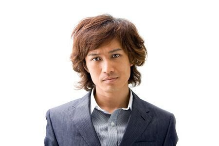 Young Asian business man's face dressed in a gray pinstripe suit , isolated Stock Photo - 3426226