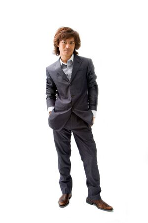 Young Asian business man dressed in a gray pinstripe suit with hands in pockets, isolated Reklamní fotografie - 3426224
