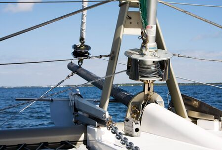 ship bow: The bow of a Catamaran as seen from the ship itself focusing on the spools that control the front sails